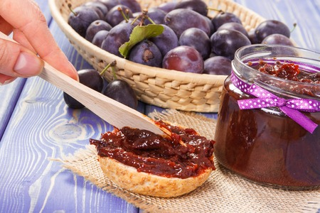 Preparing sandwiches with homemade plum marmalade or jam, concept of healthy sweet snack, breakfast or dessert Stok Fotoğraf