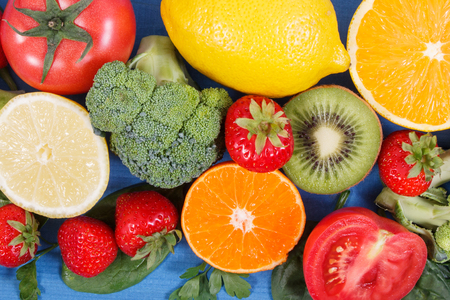 containing: Fresh ripe fruits and vegetables as sources of minerals containing vitamin C, dietary fiber and minerals, healthy nutrition and strengthening immunity concept