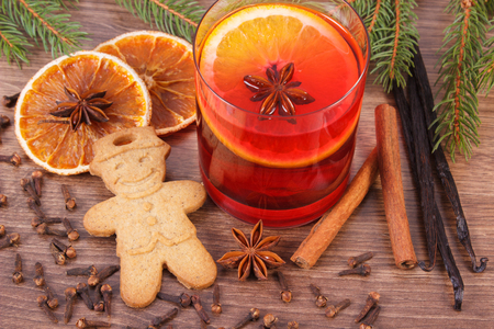 Mulled wine, gingerbread or Christmas cookies on winter evening, spruce branches and spices