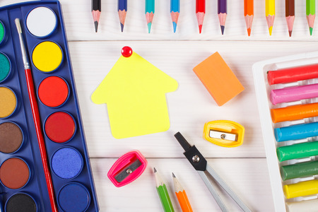 School and office accessories, paper in shape of building on white boards