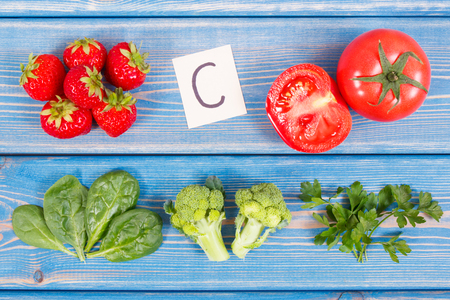 Fresh fruits and vegetables containing vitamin C and fiber, concept of healthy food and strengthening immunity Stock Photo
