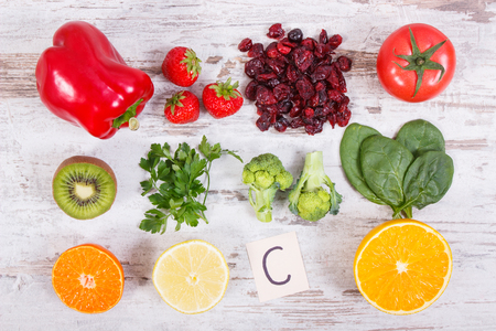 Fresh fruits and vegetables as sources vitamin C, natural minerals and dietary fiber, healthy food and strengthening immunity concept Stock Photo