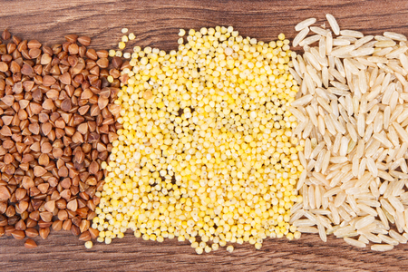 Buckwheat, millet groats and brown rice, concept of healthy, gluten free food and nutrition Standard-Bild
