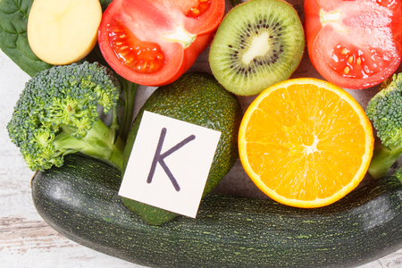Fresh fruits and vegetables containing vitamin K, dietary fiber and minerals, concept of healthy nutrition Stockfoto