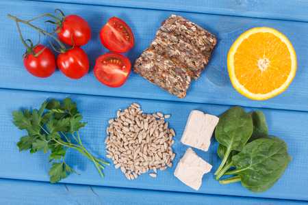 Nutritious products containing vitamin B9, natural sources of minerals and folic acid, concept of healthy nutrition Фото со стока
