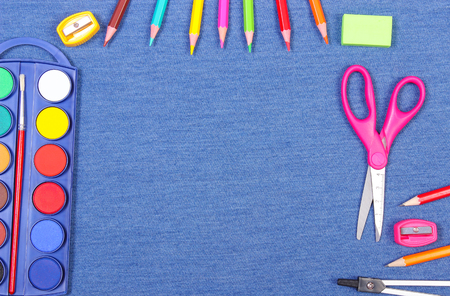 School and office supplies on jeans background, copy space for text or inscription, back to school concept 版權商用圖片