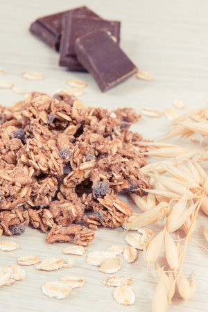 Granola, oat flakes and chocolate as source iron and fiber, concept of healthy snack