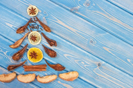 Christmas tree shape made of dried fruits and spices for preparing traditional Christmas beverage or compote, place for text