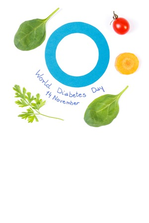 Fresh ripe vegetables and blue circle of paper as symbol of world diabetes day, copy space for text on white background