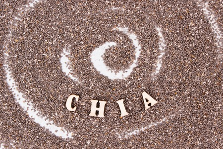 Heap of chia seeds, concept of food containing natural vitamins, minerals and dietary fiber Stock Photo