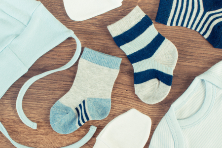 Blue clothing for newborn baby, concept of expecting for kids and extending family