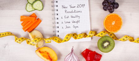 Fruits and vegetables and tape measure, new year resolutions of healthy, sporty lifestyles concept