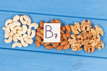 Various nuts as source vitamin B7, dietary fiber and natural minerals, concept of nutritious eating Imagens