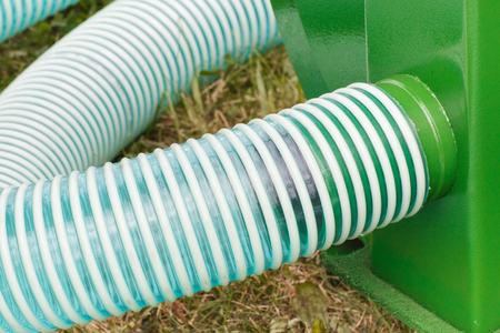 Plastic corrugated pipes in agricultural machine, detail and part of industrial hydraulic or pneumatic machinery, technology and engineering concept