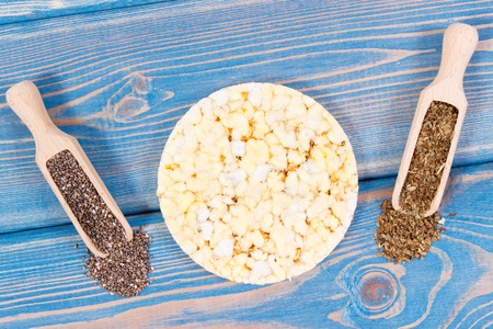 Crunchy rice or corn waffles with chia seeds and oregano, concept of healthy dietary breakfast Stock Photo