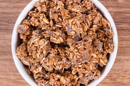 Oat flakes with chocolate as source iron and fiber, healthy snack or dessert concept