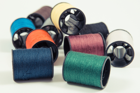 Colorful spools of thread. Accessories for needlework or sewing