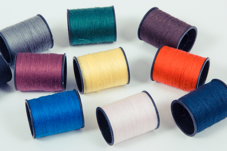 Spools of colorful thread using for needlework, embroidery and sewing Imagens