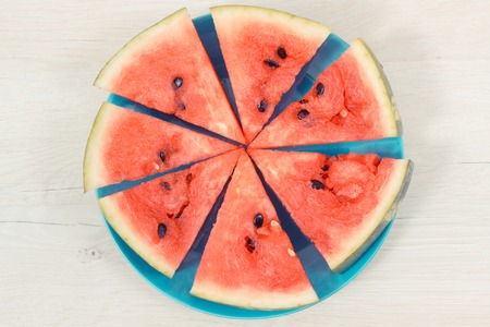 Vintage photo, Slice of fresh watermelon on blue plate, concept of healthy delicious and juicy dessert