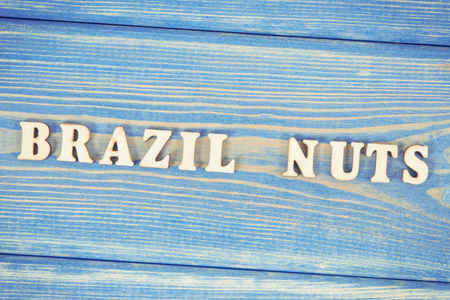 Vintage photo, Inscription brazil nuts on old blue boards