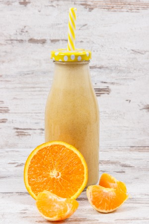 Freshly blended coctail or smoothie from citrus fruits as healthy dessert containing natural vitamins and minerals