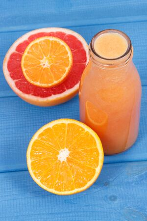 Fresh healthy smoothie from citrus fruits. Dessert containing natural vitamins. Dieting and slimming concept