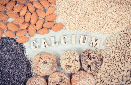 Vintage photo, Inscription calcium and natural food containing dietary fiber and minerals, concept of healthy nutrition
