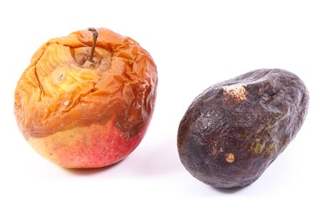 Old wrinkled moldy apple and avocado on white background, unhealthy and disgusting eating