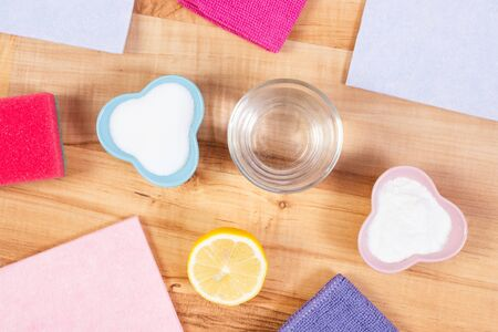 Accessories and natural detergents for cleaning different surfaces and rooms at home, concept of household duties