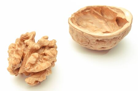 Closeup of fresh walnut with nutshell on white background Imagens