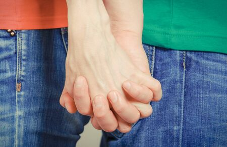 Hands of man and woman in handshake, couple holding hands. Positive emotions concept