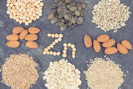 Inscription Zn with healthy nutritious eating containing zinc, vitamins, minerals and dietary fiber 写真素材