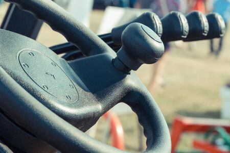 Steering wheel and operating control panels or levers in forklift or other industrial or agricultural machine