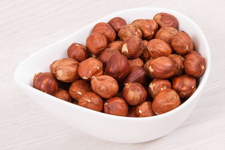 Healthy hazelnuts containing natural vitamin, minerals and acids, nutritious eating concept Фото со стока