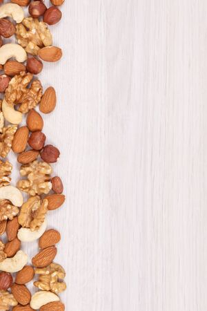 Healthy different nuts and almonds as source natural vitamins and minerals, nutritious eating concept, copy space for text Фото со стока