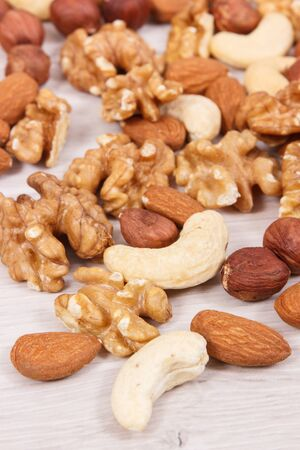 Various nuts and almonds containing healthy natural vitamins and minerals, nutritious eating concept