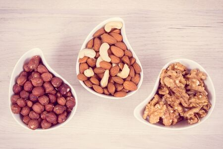 Healthy different nuts and almonds containing natural vitamin, minerals and acids, nutritious eating concept