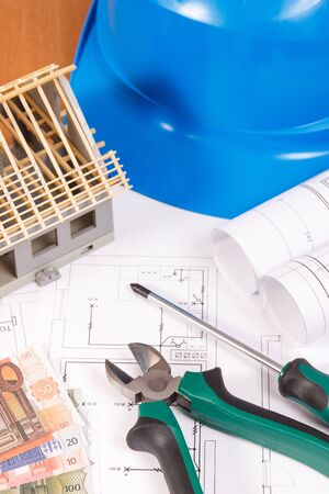 Electrical construction drawings or diagrams, work tools for engineer jobs, small house and currencies euro, building home cost