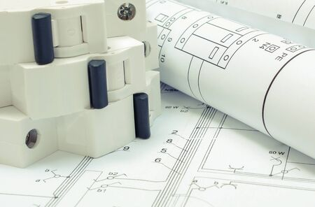 Electrical diagrams and electric fuse on construction drawing of house. Concept of building home 版權商用圖片