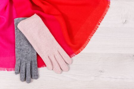 Warm womanly woolen or cotton gloves and shawl for using in autumn or winter