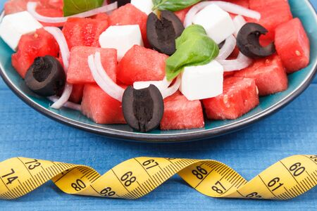 Summer salad of watermelon and feta cheese as source healthy natural vitamins and minerals Stock Photo