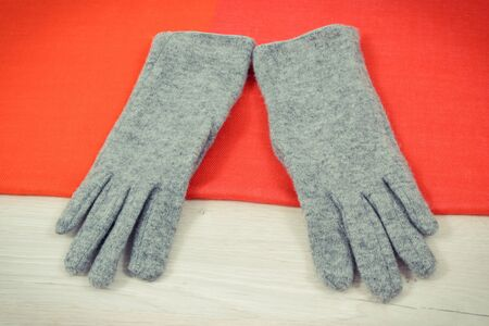 Warm womanly woolen gloves and shawl for using in autumn or winter