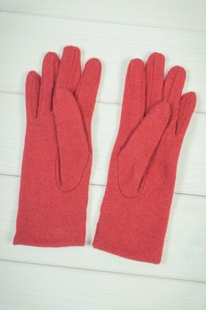Vintage photo, Woolen gloves for woman on white boards, warm clothing for autumn or winter