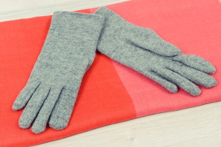 Pair of warm womanly woolen gloves and shawl for using in autumn or winter Stok Fotoğraf