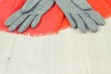 Warm womanly woolen or cotton gloves and shawl for using in autumn or winter, copy space for text or inscription