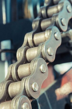 Metal chain in agricultural or industrial machinery. Technology concept