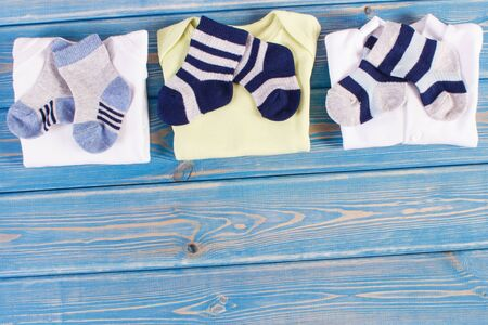 Clothes for little baby boy, extending family concept, copy space for text or inscription on blue boards Stok Fotoğraf - 131344800