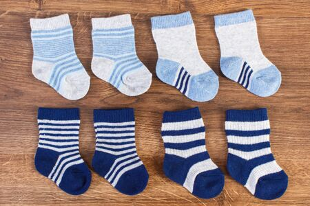 Blue socks for baby boy, expecting for kids and extending family concept