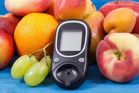 Glucose meter for checking sugar level and fresh healthy nutritious food as source natural vitamins and minerals, diabetes concept Stok Fotoğraf - 132094228