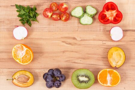 Frame of fresh healthy nutritious fruits and vegetables as source vitamins, dietary fiber and minerals, place for text or inscription